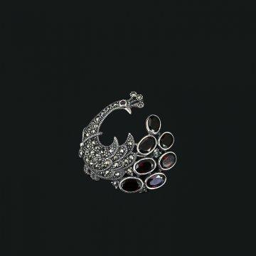 Серебряная брошь-подвеска Птица (марказит, гранат)