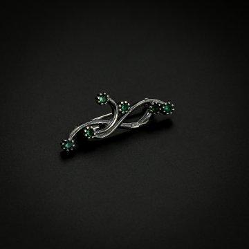 Серебряная брошь Завитки (фианит зелёный)